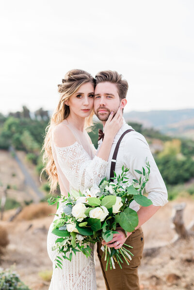Boho Bride and Groom snuggle up for romantics for their wedding in Temecula Ca