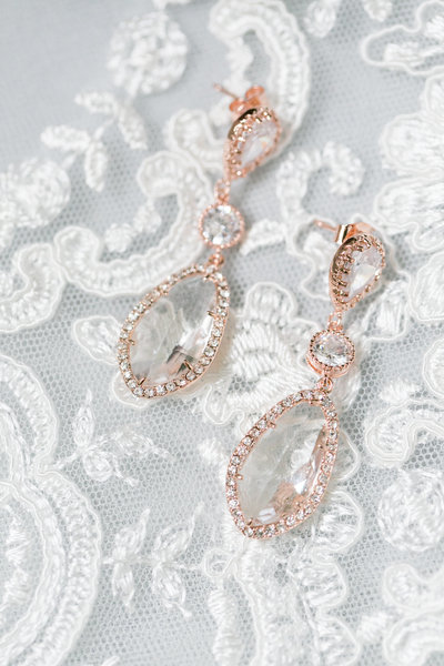 Wedding earrings on lace dress at Springfield Manor