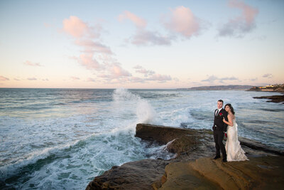 Bride and Groom on cliffside at San Diego elopement