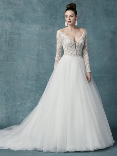 Long Sleeve Ball Gown Wedding Dress. Sexy, romantic, and utterly feminine, this long-sleeve ball gown wedding dress is a transformative thing to behold, but even better to wear IRL.