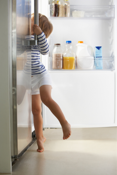 Thrive by Spectrum Pediatrics image for we are here for you every step of the way is an independent child reaching into refrigerator for food to eat