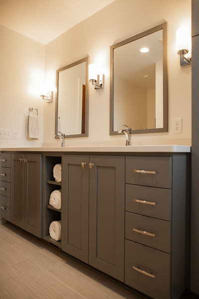 vanity with open cubbies and white countertop