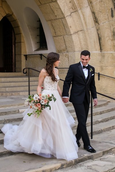 Gorgeous Bride and Handsome Groom walking down steps after wedding in Arizona