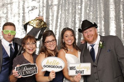 bride and family having fun holding funny props