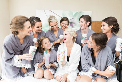 Bride and bridesmaids in robes getting ready  and drinking starbucks