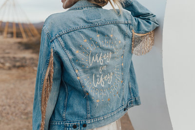 woman wearing embroidered jean jacket