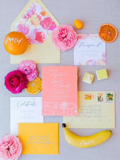 yellow and hot pink wedding stationery