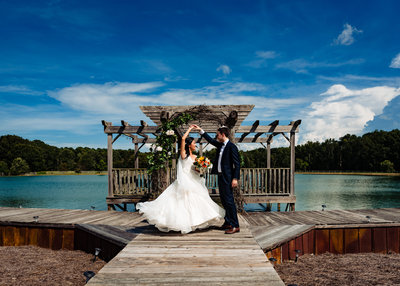 Bride and groom dance on a dock at the Barn at Woodlake Meadows