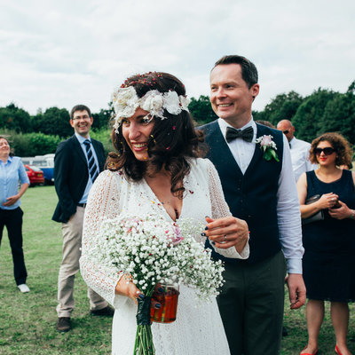 Laughing bride and groom photograph at bohemian outdoor wedding at the keeper and the dell in Norfolk