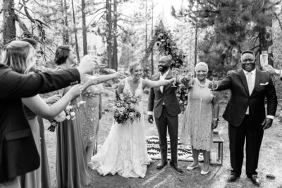 Family cheers with champagne after wedding ceremony. Photo taken by Cheers Babe Photo.