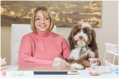 Laura Lee and Cricket | woman in pink sweater with labradoodle