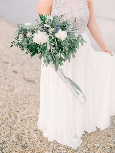Bride holding her bridal flower bouquet