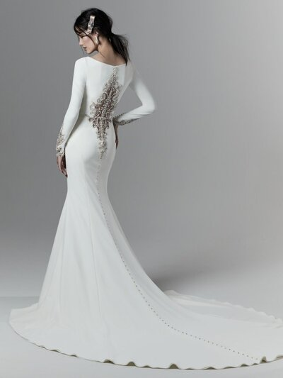 Crepe Fit-and-Flare Wedding Dress. Full disclosure, the crystal-embellished cuffs on this crepe fit-and-flare wedding dress can be quite distracting.