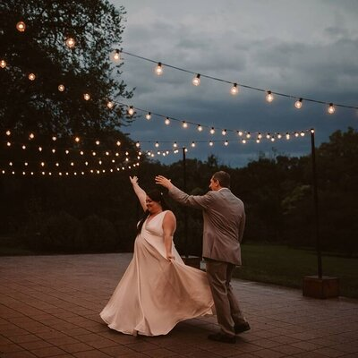 Bride and groom dancing at reception after Morton Arboretum wedding in Chicago