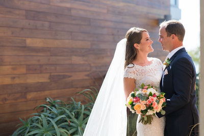 Bride and Groom smiling at Scripps Seaside Forum