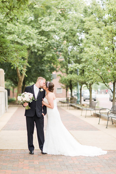 Bride and Groom kissing photographed at the Onesto in downtown Canton by a akron ohio wedding photographer