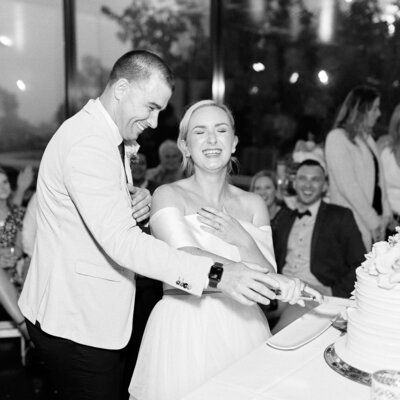 Bride and groom laughing while cutting cake at their Hydro Majestic Blue Mountains Wedding