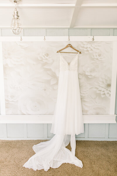 Bride's dress hangs in bridal suite at Hydrangea Blu Barn wedding photo by Cynthia Boyle wedding photographer in Grand Rapids