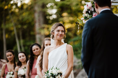 Bride smiles at groom during wedding ceremony at Rosemont Historic Springs in Virginia