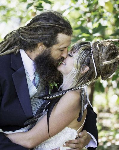Bearded groom kisses his new wife