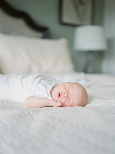 Baby laying on bed during Maryland newborn session