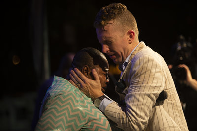 Evangelist Jonathan Shuttlesworth prays for a woman with cancer at Festival of Life in Newark NJ