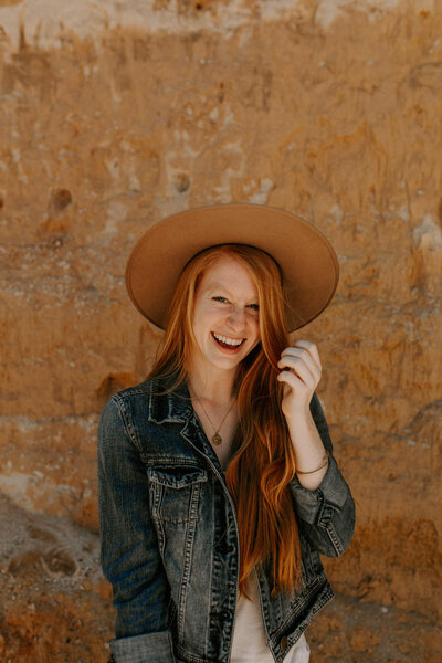 woman at providence canyon state park wearing a hat and smiling