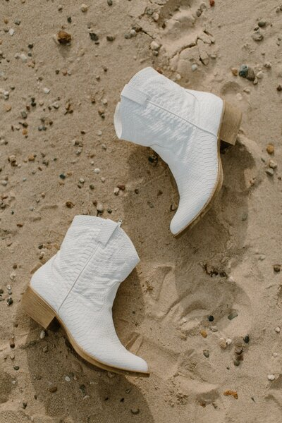 white boots on beach