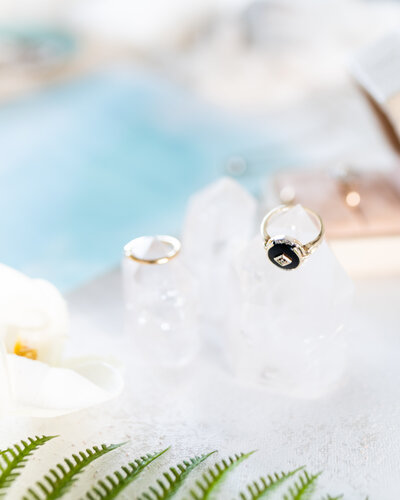 wedding ring and engagement ring on flat surface