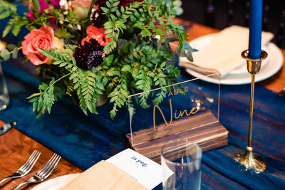 Wedding Reception with flower bouquet and table numbers