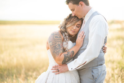 Bride and groom in Colorado field at sunset