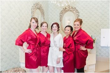 bride getting ready with bridesmaids on wedding day at Ryan Nicholas Inn