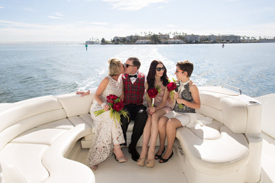 Bride, groom and family on boat at San Diego Elopement