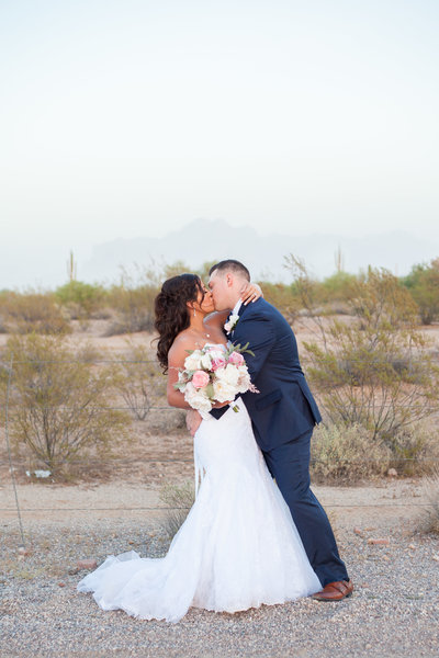 bride and groom kiss dip desert