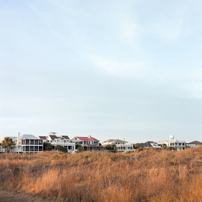 A row of Sullivan's Island beach houses behind beach grass