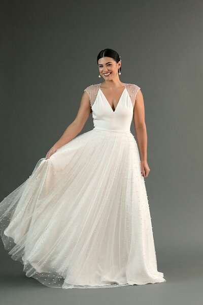 Photo link to more details about the Chika pearl beaded wedding dress