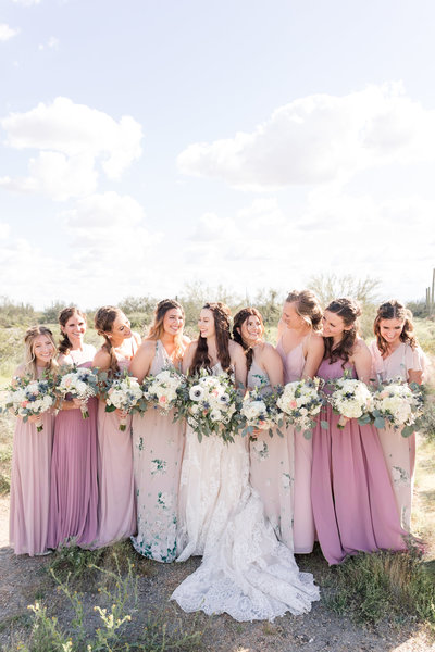 Bridesmaids gather together at a desert wedding