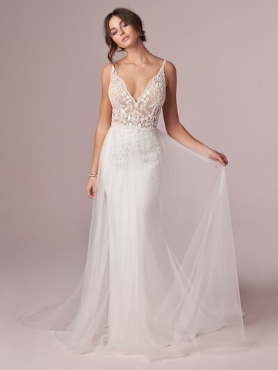 Sexy V-back Sheath Wedding Dress. You're shopping for your dream sheath wedding dress. You imagine something delicate and timeless. You're rewarded with just that, and a hint of sexy-cool-confident to boot.