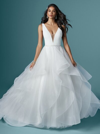 Ball Gown Wedding Dress. A ballgown wedding dress doesn't need bells and whistles to be fabulous. A chic fabrication and elegant draping does the trick just fine.