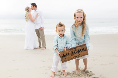 Family filled elopement on beach in San Diego California