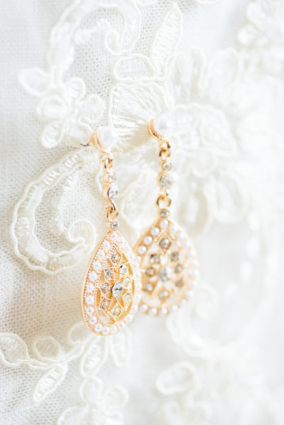 Gold earrings and white lace bridal veil by Tucson Wedding Photographer Bryan and Anh of West End Photography