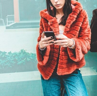 Cropped Girl In Fur Coat W:iPhone