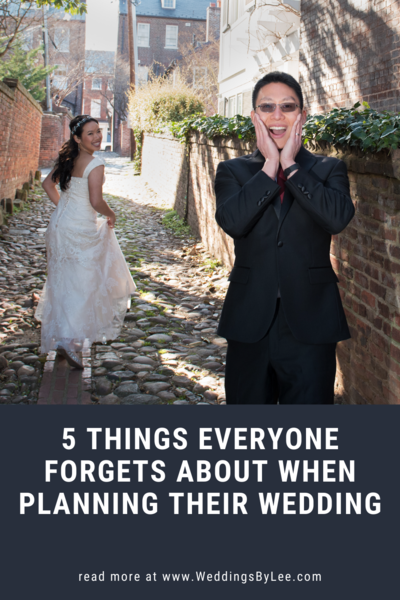 Funny photo of groom with hands on face looking shock as his bride is running away down a cobble stone road. Photographed by  a DC wedding photographer, Lee Hickman