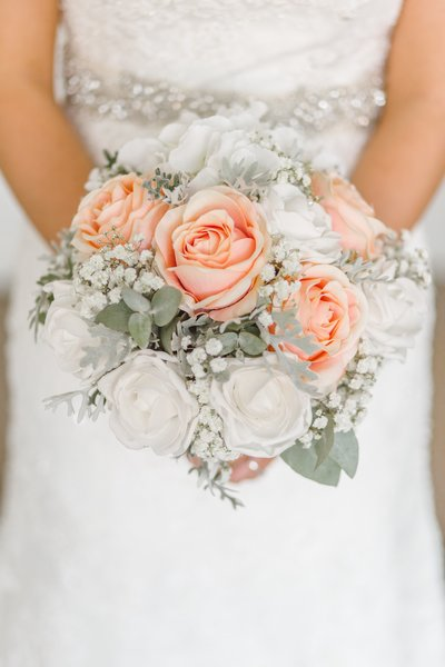 Investment - Bride Holding Flowers
