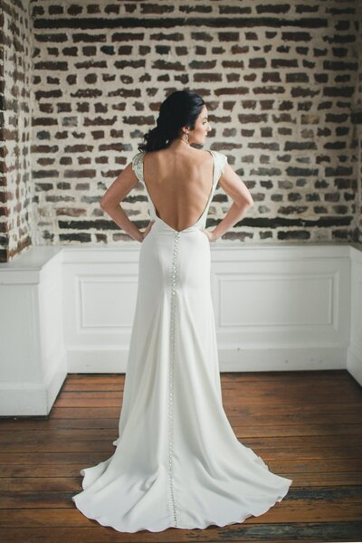 Photo link to more details about the Tamarisk crepe wedding gown