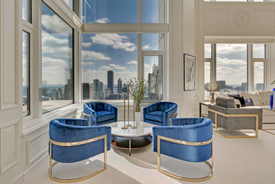 Family Room with blue and gold side chairs in a highrise