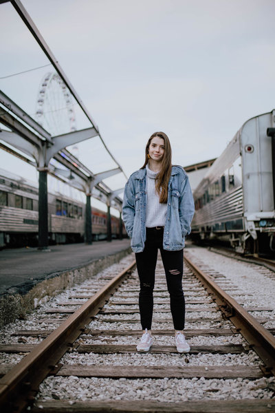 woman standing on train tracks