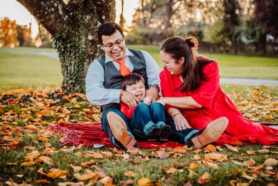 mom tickling son family photoshoot