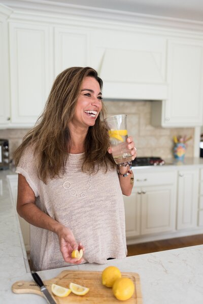 Nashville business owner posing with lemon water and lemons for coach personal brand photos