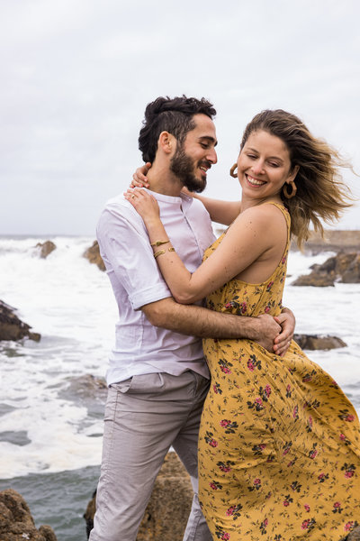 Couple laughing during a Miami Beach couples photoshoot